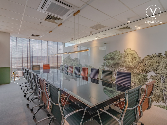 boardroom meeting space with forest wallpaper
