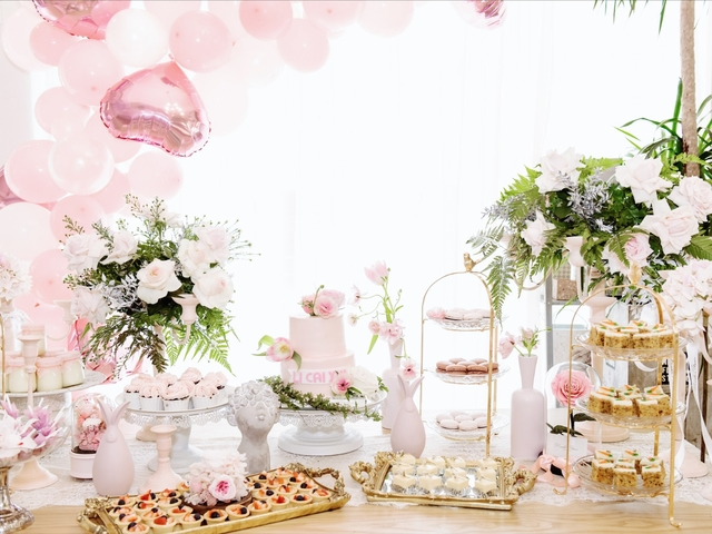 pink dessert table for baby shower event
