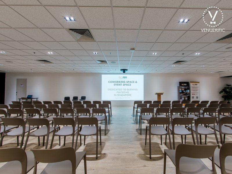 corporate seminar with theatre setting and screen with projector