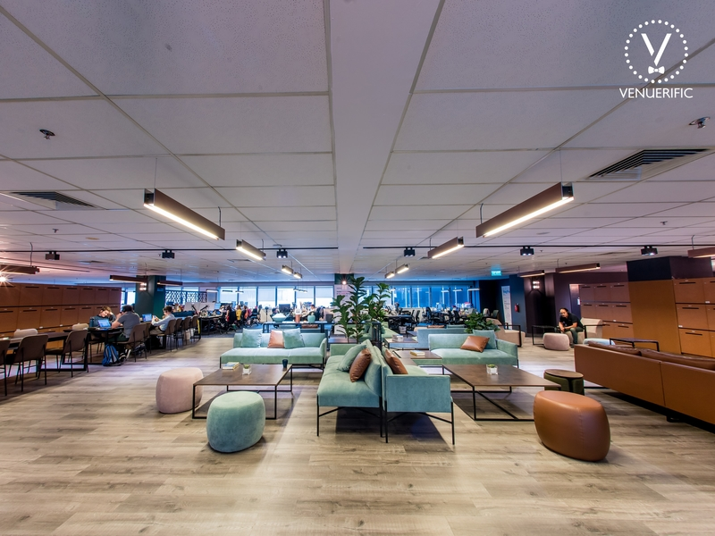 coworking space with shared desks and couch lounge by hong leong holdings