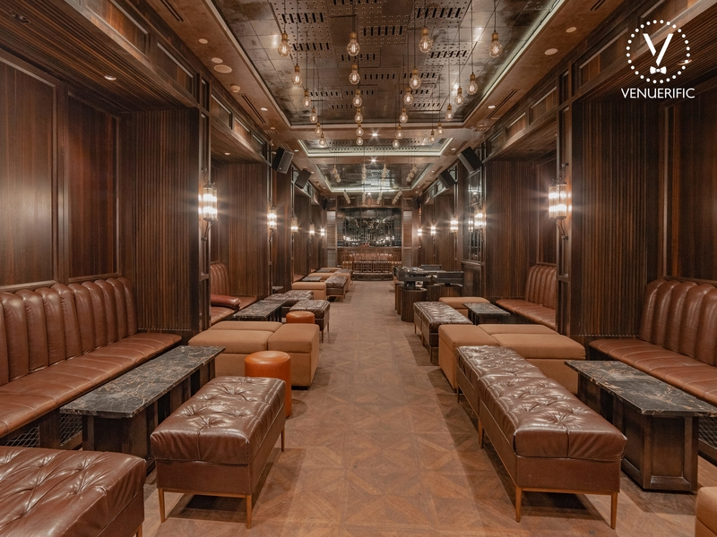 wooden wall party venue in kuala lumpur with several long couches