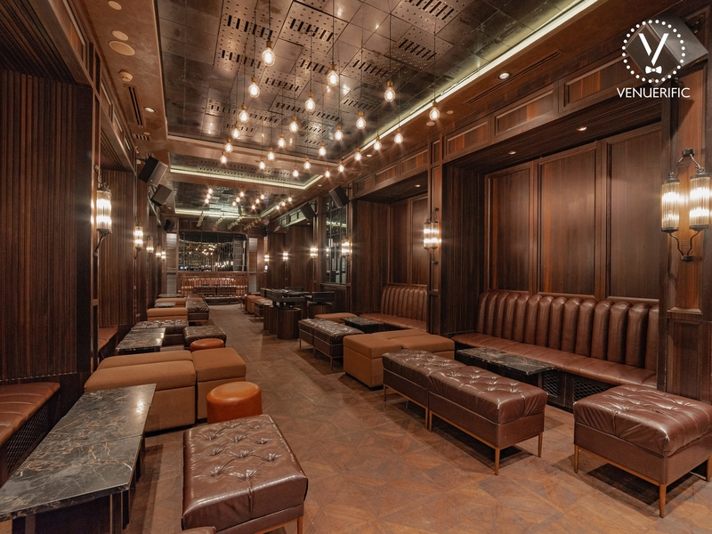 elegant seminar room in kuala lumpur with wooden interior and couches