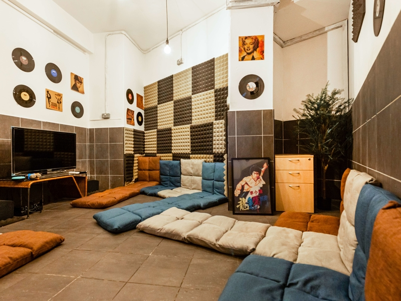 private room for karaoke with colourful floor couch