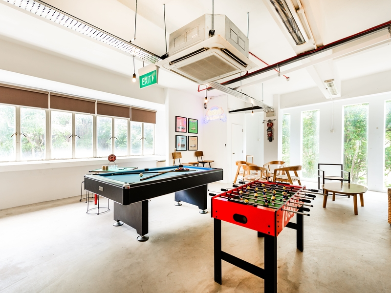 room with billiard table and soccer table games
