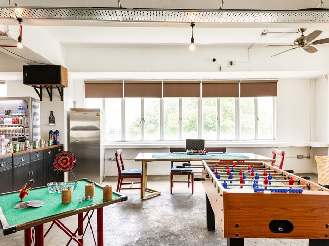 event space with games and big windows with natural light