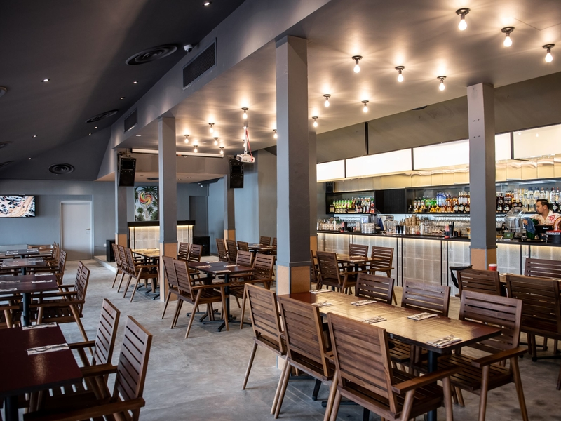 high ceiling event space with wooden dining table