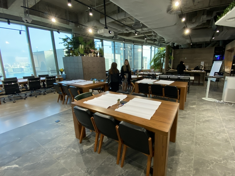 coworking space area with industrial look and green plants