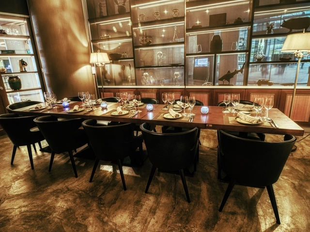 12 capacity table table set up for private dining event