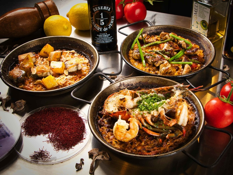 spanish dishes name parlla ola valenciana and fiduea de cigalas