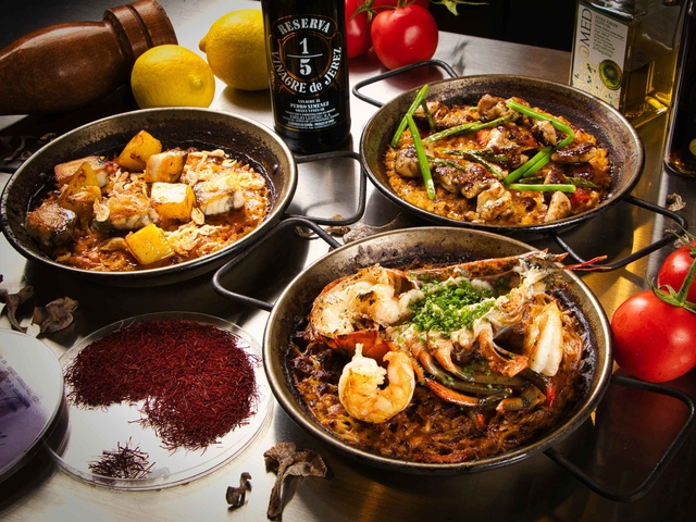spanish dishes name parlla ola valenciana and fiduea de cigalas