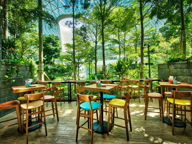 birthday event space with wooden bar stools and waterfall views