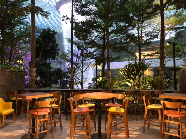 restaurant in jewel changi singapore with views of waterfall