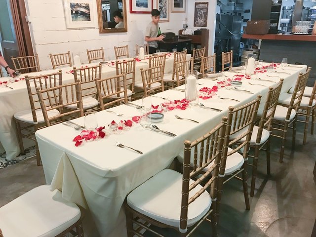 intimate wedding party table set up for guest with gold chairs