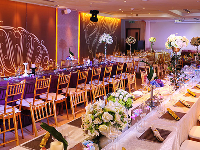 private wedding celebration using long table setup and white flower decoration on the table