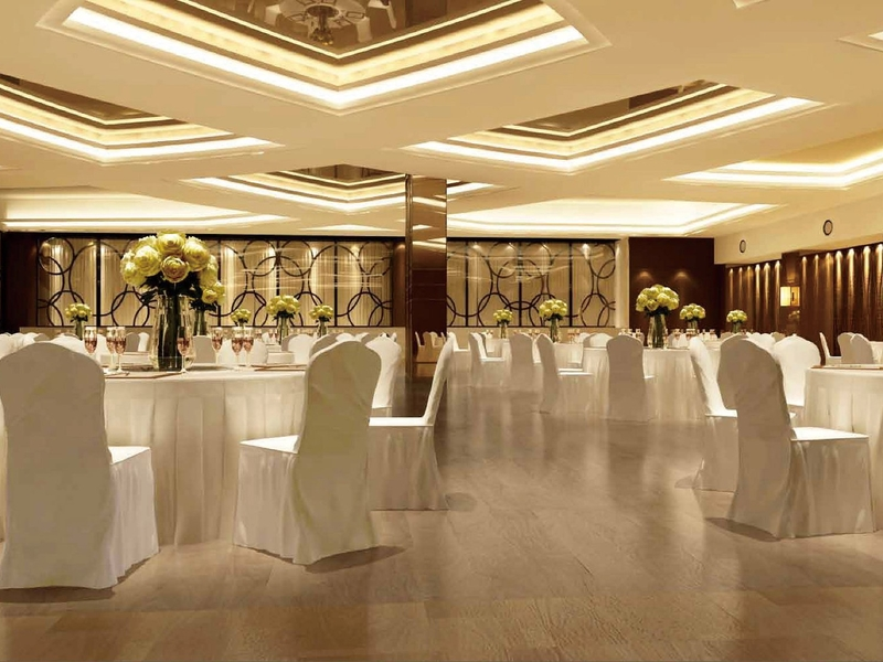 ballroom with round table setup and flower vase  for each table