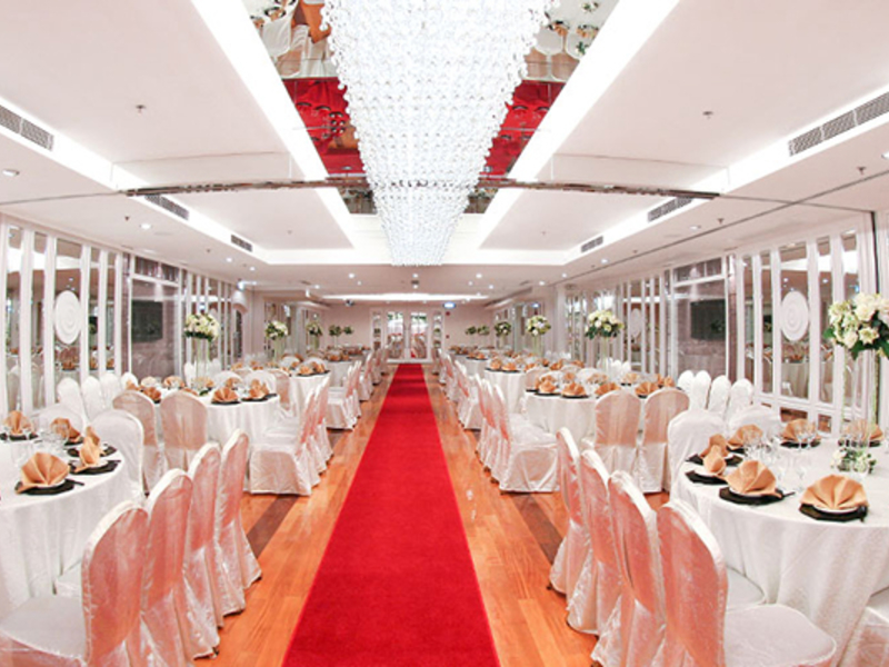 ballroom with crystal chandelier and red carpet accross the room