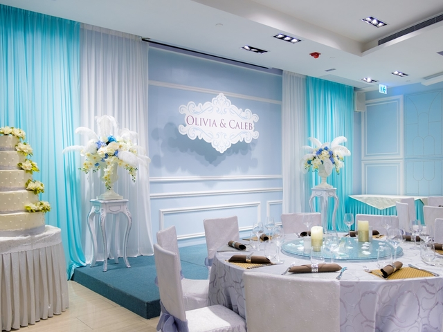blue and white wedding theme of olivia & caleb with simple mini stage featuring flower vases