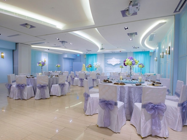 function hall with round table setup for intimate wedding dinner