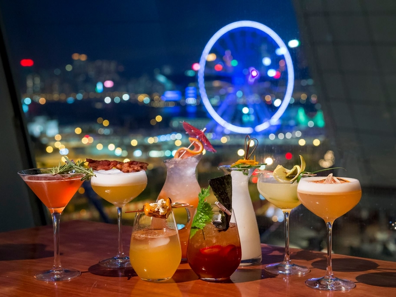cocktail drinks with panoramic view of hong kong at night