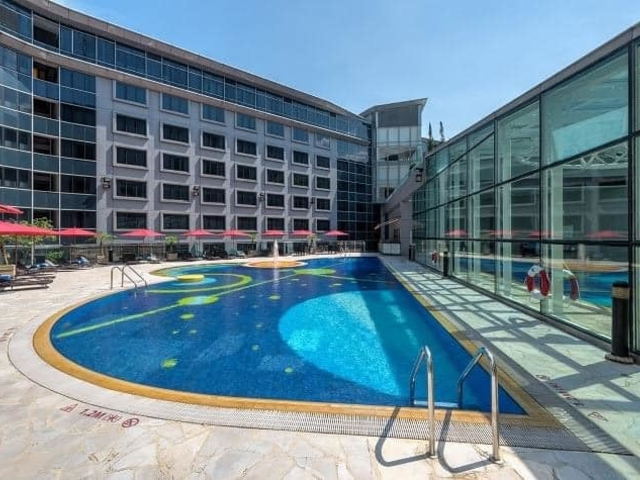 outdoor swimming pool with the view of the hotel bulding
