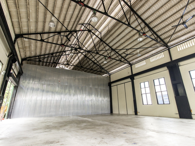 large warehouse in singapore with track lights and large windows
