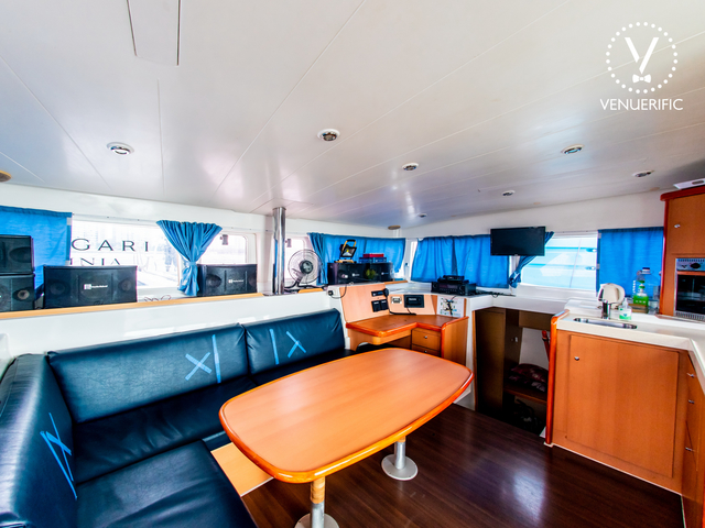 singapore yacht main deck with mini pantry and long black couch
