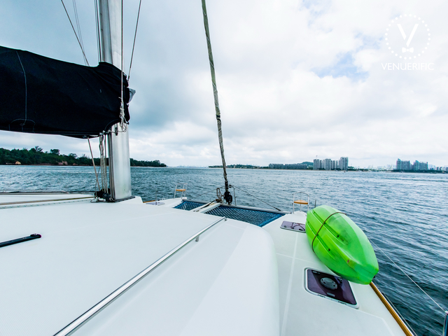 sun deck of singapore white yacht equipped with green kayak
