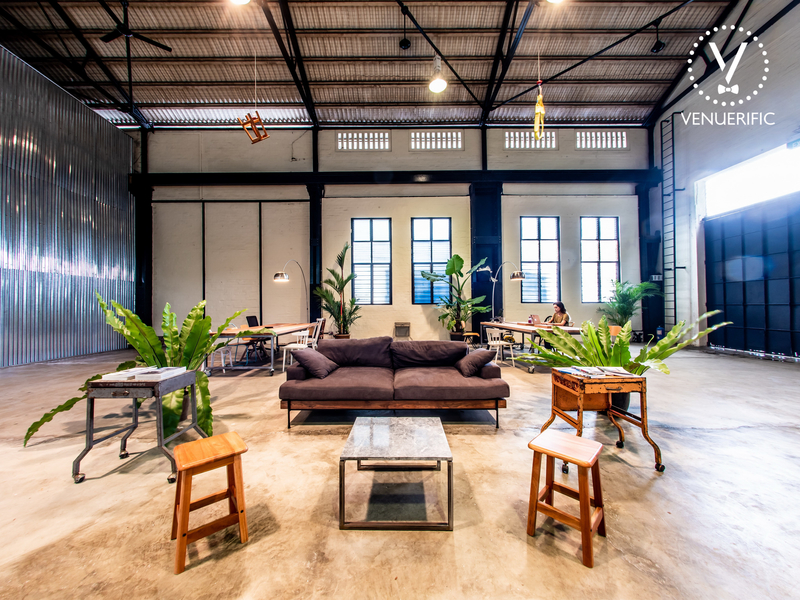 birthday party warehouse in singapore with long couch and plants decorations