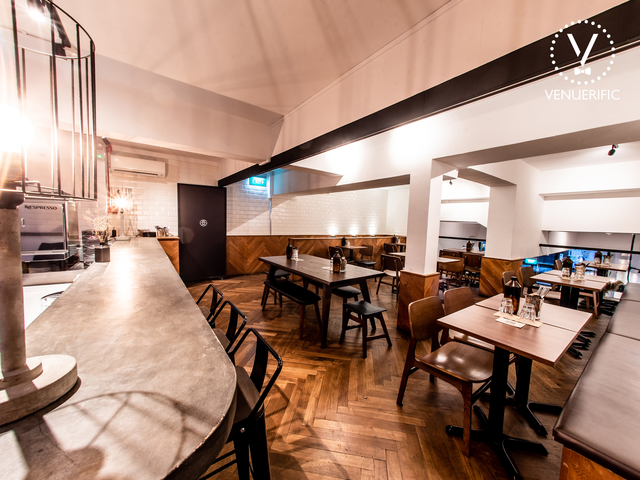 singapore product launch venue with wooden interior and mini bar
