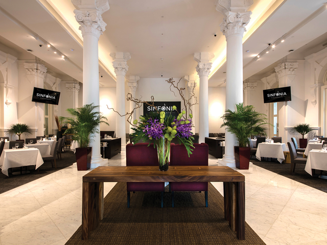 singapore white theme wedding venue with several pillars and tv screen