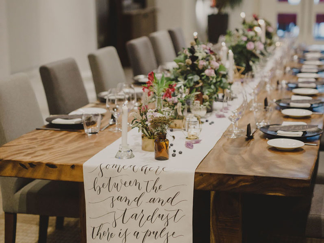 birthday party venue in singapore with long wooden table decorated with flowers and candle