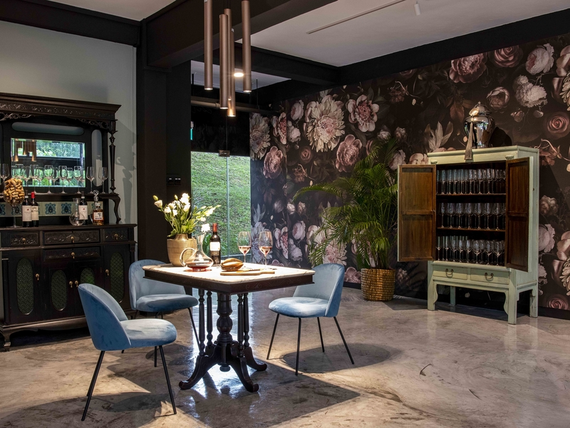 dining table overlooking floral wallpaper and unique decorations