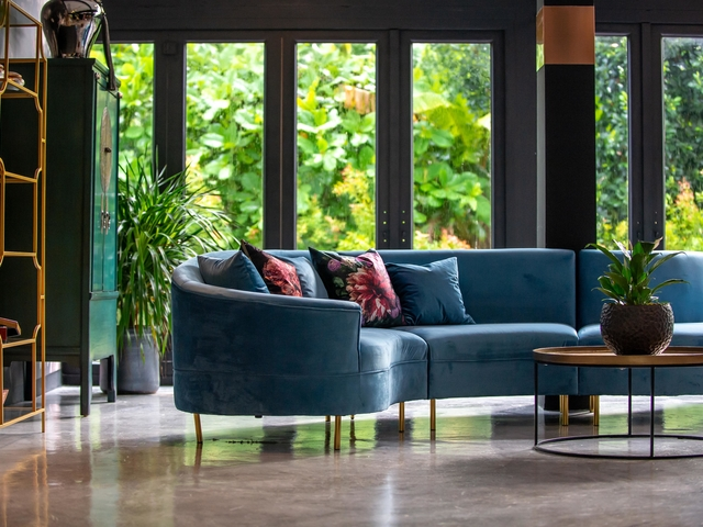 lounge area with blue sofa and cushions
