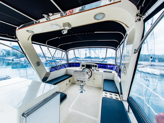 black ceiling singapore yacht with large control area