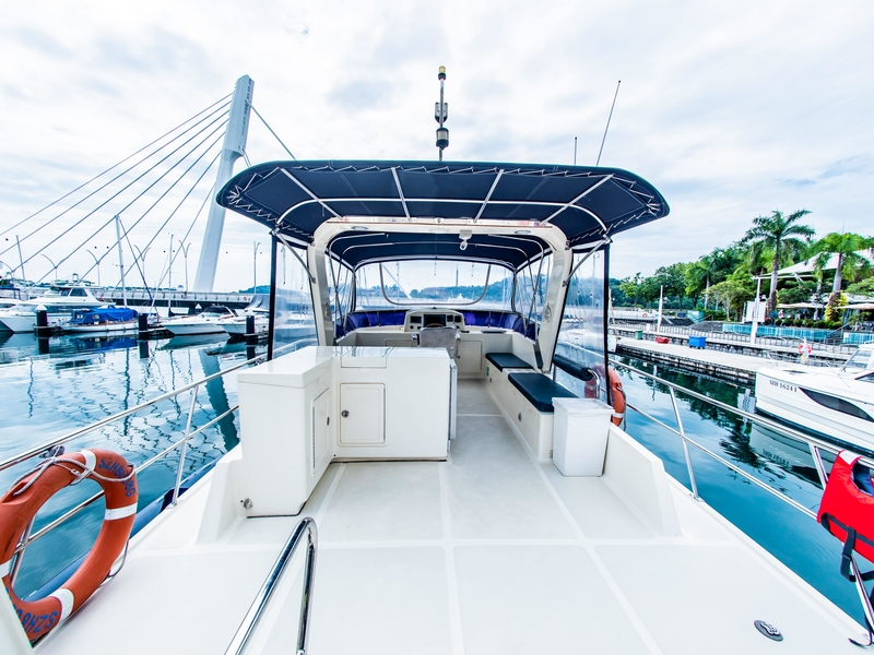 yacht in singapore with large deck area and white interior