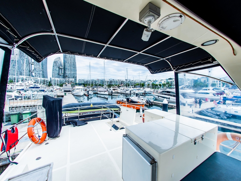 small singapore yacht with white interior