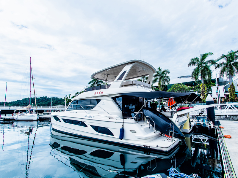 white birthday yacht in singapore with black cover and 2nd floor deck