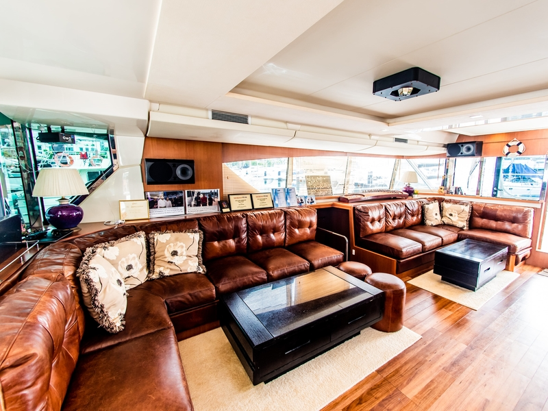 singapore large yacht with brown long couches and speakers