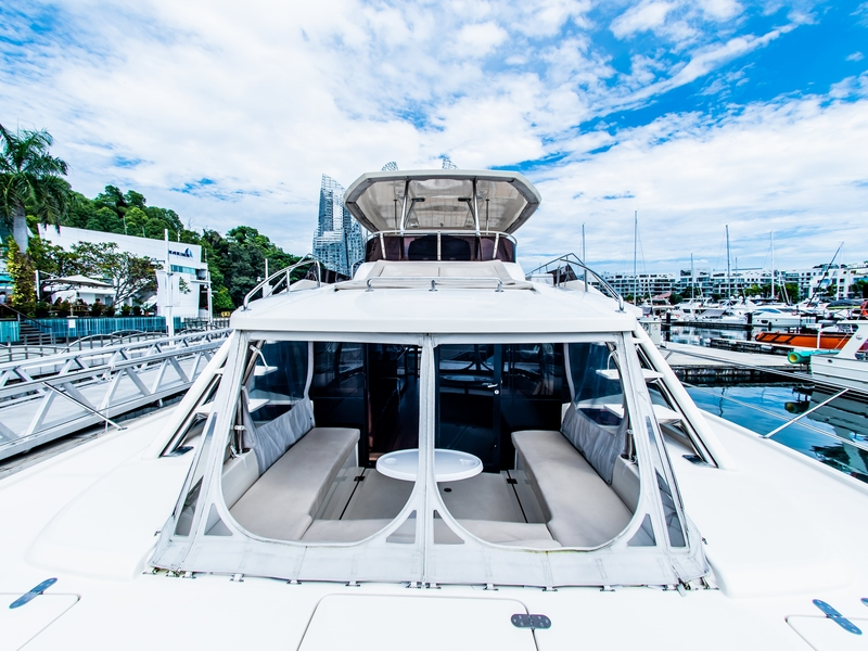 singapore yacht with white interior and u shaped seating