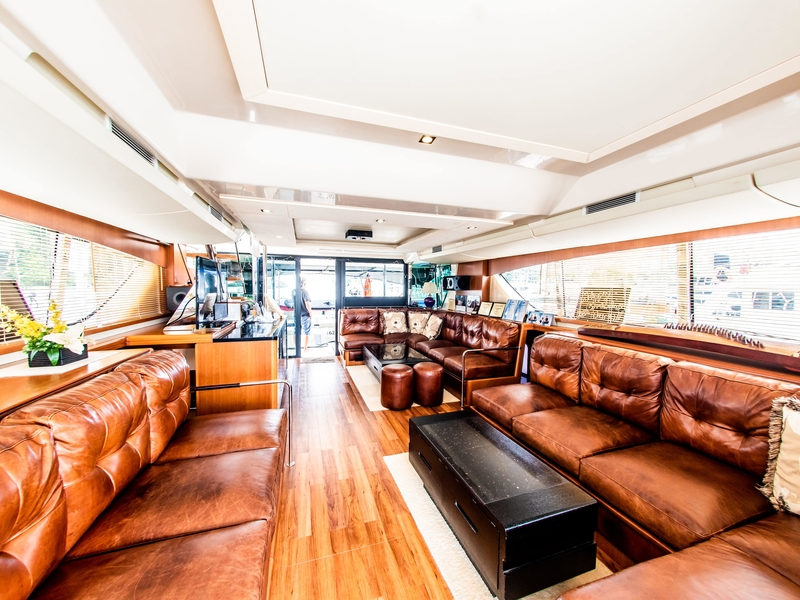 brown long couches and long windows in singapore new year yacht