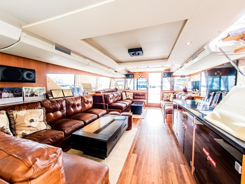 brown couches and long table in singapore large yacht