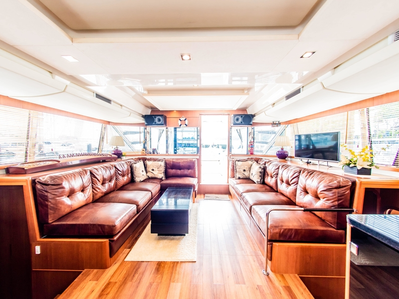 brown long couches and tv screen in singapore event yacht