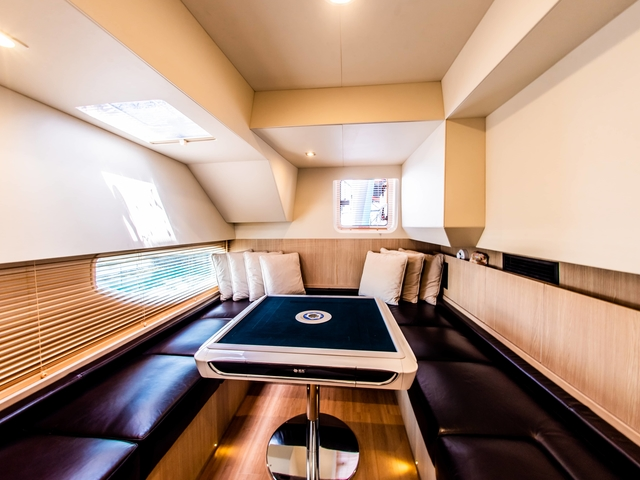 u-shaped seating and square table in singapore yacht