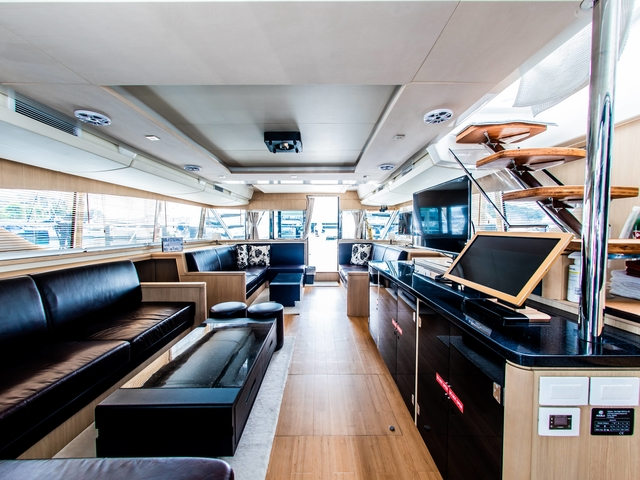 wooden floors and long black couches in singapore yacht