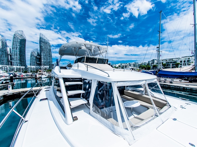 singapore white yacht equipped with low stairs to upper deck area