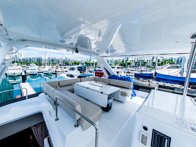 foldable table and u shaped seating in singapore upper deck yacht