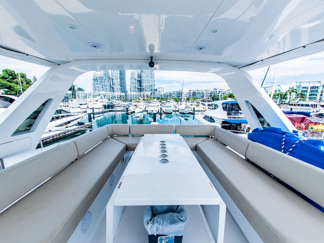 singapore propose yacht with u shaped seating and long white table