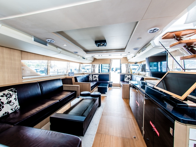 singapore business yacht with large main deck and long couches