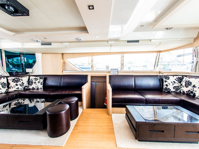 singapore private yacht equipped with dark brown couches and low square table