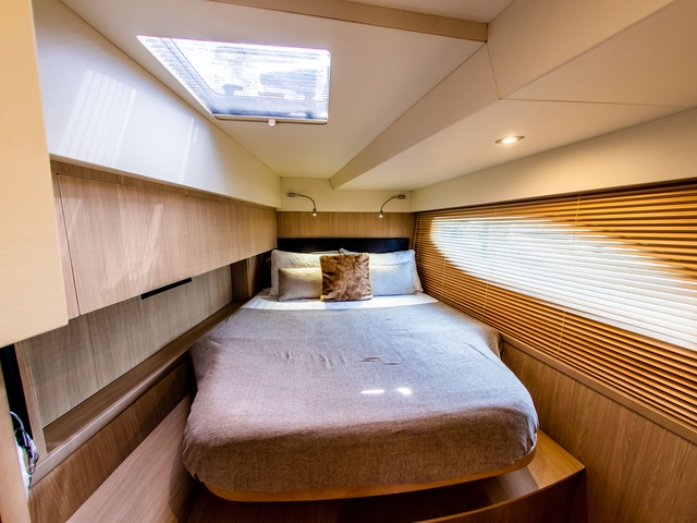 singapore honeymoon yacht with master bedroom and small glass roof